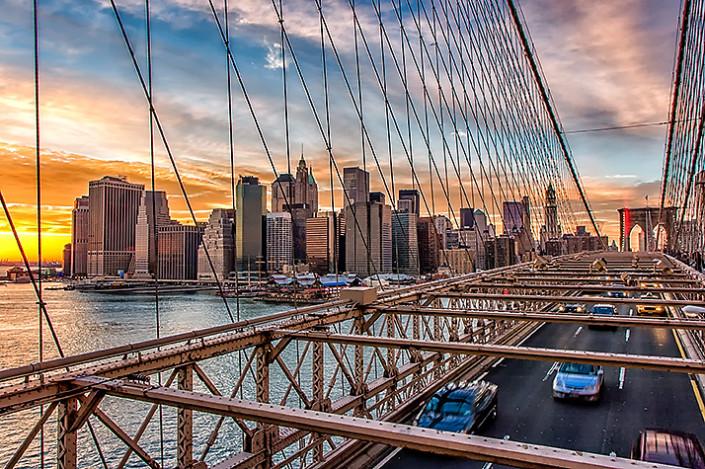Lower Manhattan at sunset via the Brooklyn Bridge