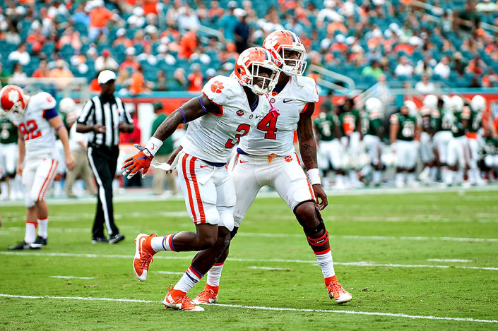 Clemson WR #3, Artavis Scott, and QB #4, Deshaun Watson, celebrate a touchdown against Miami