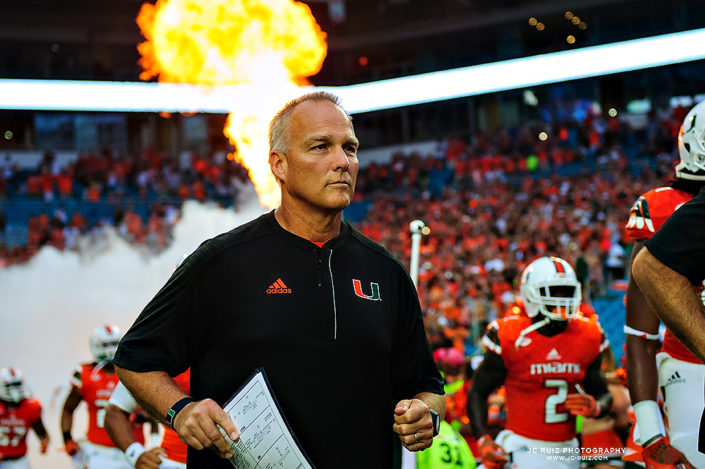 Mark Richt runs through the smoke