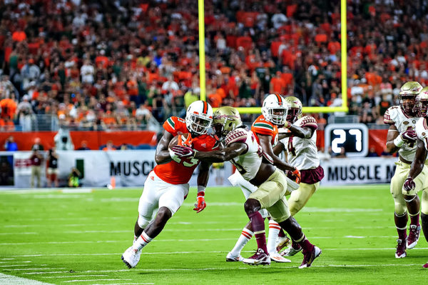Hurricanes TE, Christopher Herndon, tries to elude the tackle from a FSU defender