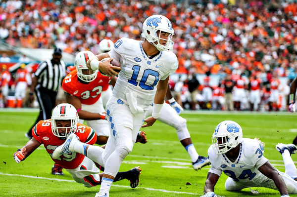 North Carolina QB, Mitch Trubisky, eludes the tackle of Corn Elder