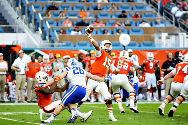 Brad Kaaya throws from the pocket