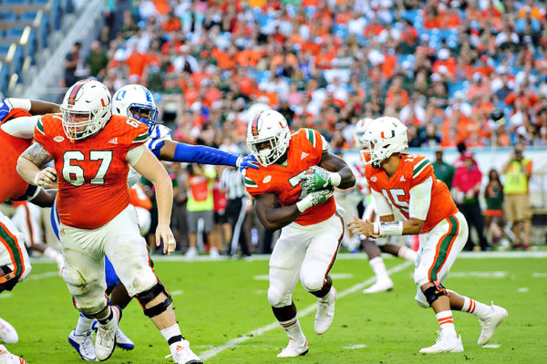 Hurricanes RB, Gus Edwards, rushes against Duke