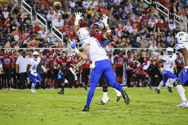 Memphis QB, Riley Ferguson, tries to throw a pass by a defender