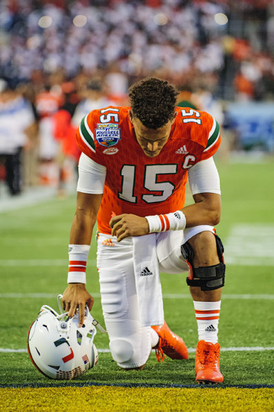 Brad Kaaya, Miami Hurricanes QB, prays before the start of the Russell Athletic Bowl