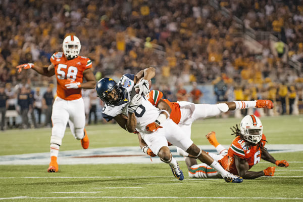 West Virginia WR, Daikiel Shorts, gets tackled