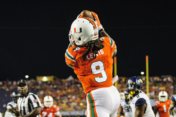Malcom Lewis, Miami Hurricanes WR, catches a touchdown pass