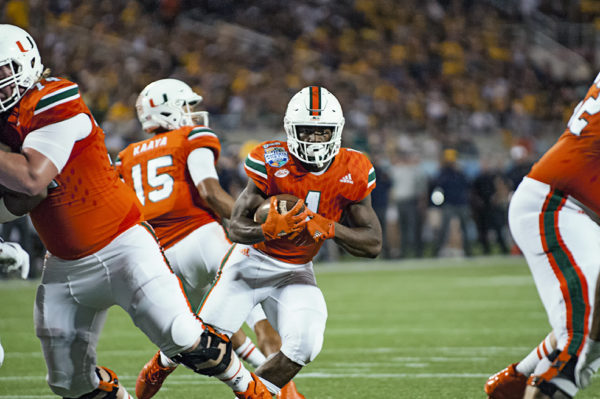 Miami Hurricanes RB, Mark Walton, looks for an opening to run through