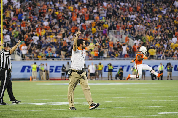 Miami Hurricanes defensive coordinator, Manny Diaz, celebrates the team's fumble recovery