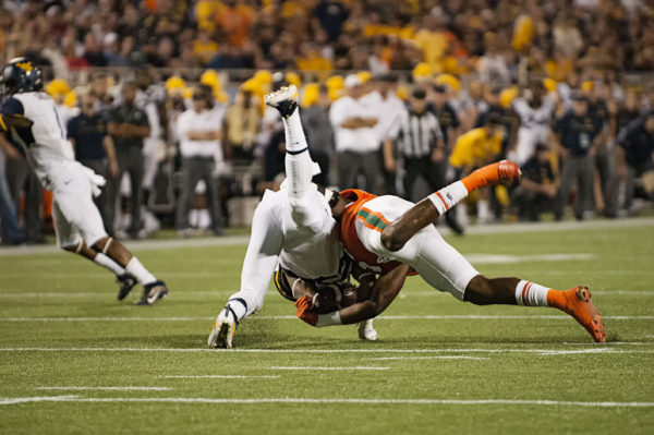 Miami Hurricanes LB, Zach McCloud, takes down West Virginia RB, Justin Crawford