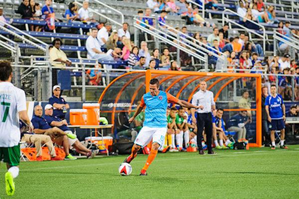 Miami FC defender, Hunter Freeman, passes the ball