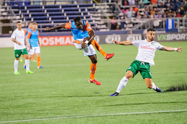 Miami FC midfielder, Kwadwo Poku, attempts a shot