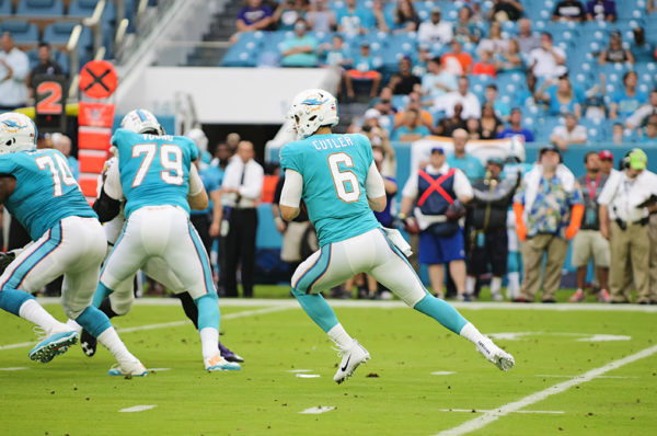 Jay Cutler, Dolphins QB #6, looks to throw down field