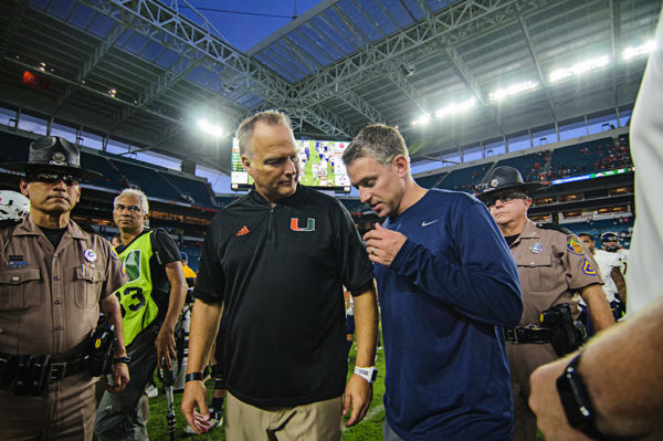 Both head coaches exchange best wishes after the game