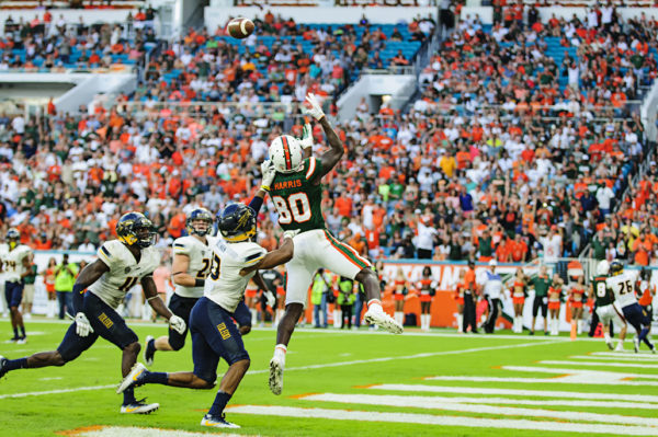 Hurricanes WR, Dayall Harris, leaps to haul in his first touchdown pass of the season