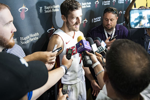 Heat point guard, Goran Dragic, is surrounded by media
