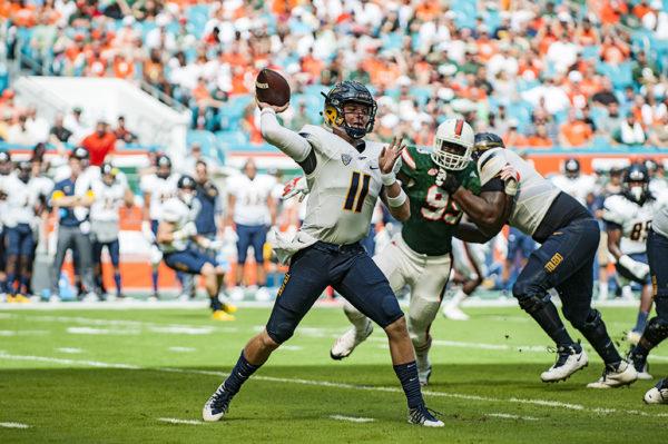 Toledo QB, Logan Woodside, throws a pass