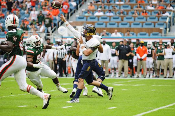 Logan Woodside launches a pass