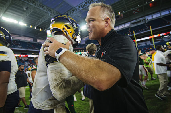 Mark Richt gives words of encouragement to Logan Woodside