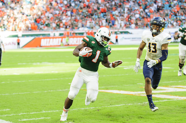 Mark Walton rushes with one shoe