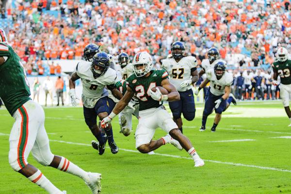 Travis Homer runs for a touchdown