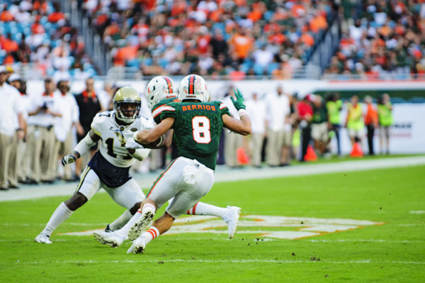 Braxton Berrios tries to make a cut after catching a pass