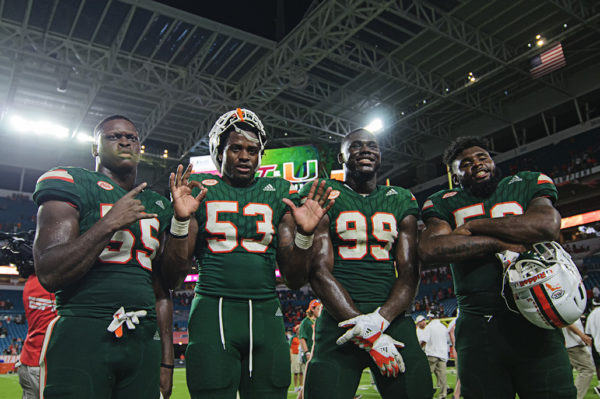Hurricanes players pose after the game