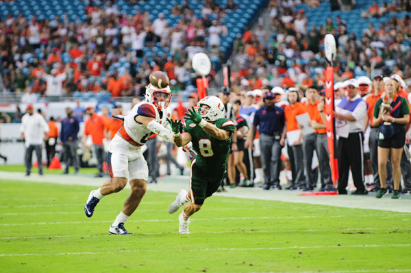 Hurricanes WR, Braxton Berrios, lunges for the ball