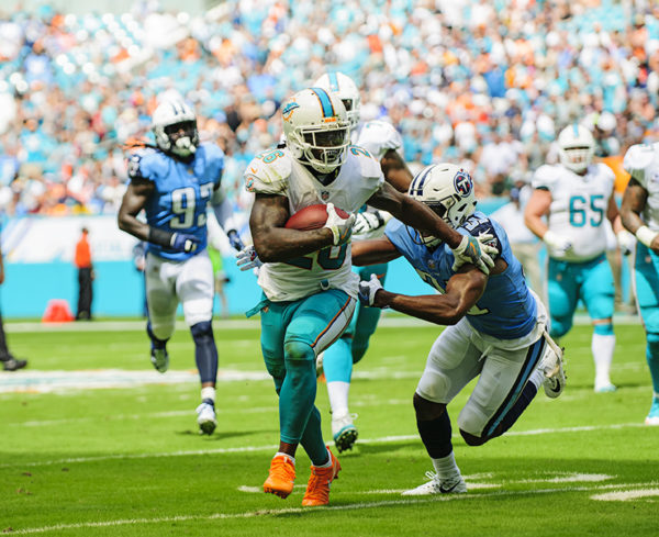 Damien Williams tries to run past a defender