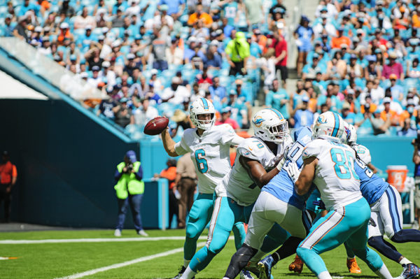 Dolphins QB, Jay Cutler, looks to throw a pass