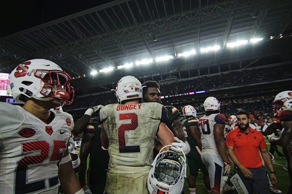 Eric Dungey (2) congrats the Canes after their win