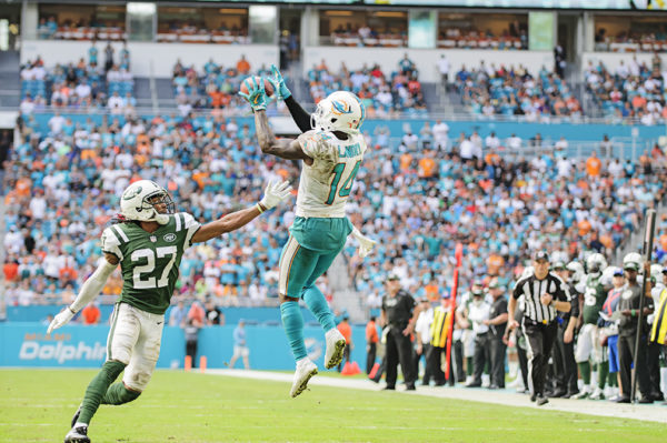 Jarvis Landry (14) leaps to catch a pass