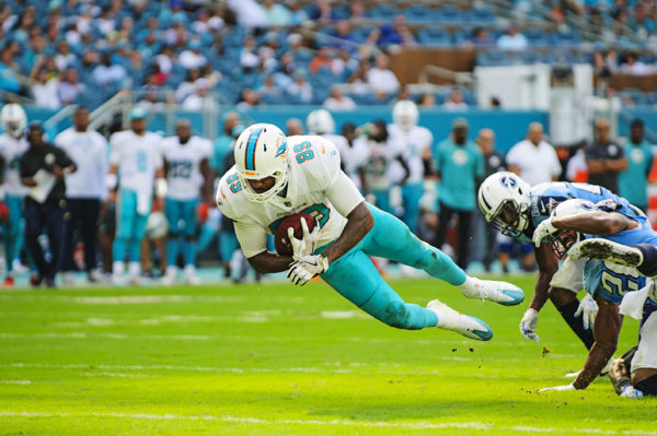 Dolphins TE, Julius Thomas, lunges for a first down