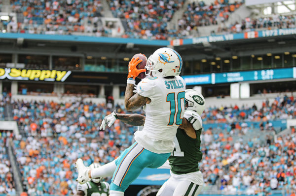 Kenny Stills (10) jumps up to haul a pass in