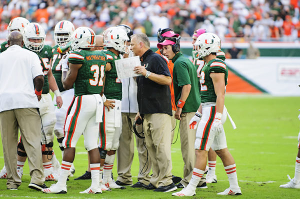 Mark Richt gives some last minute advice to Malik Rosier during a timeout