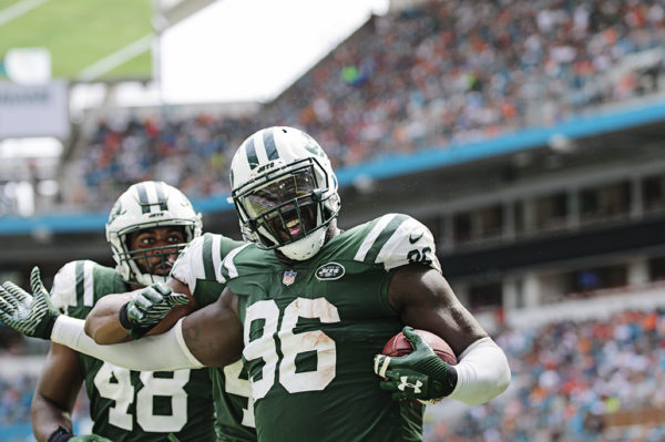 Muhammad Wilkerson (96) celebrates his interception he returned for a touchdown
