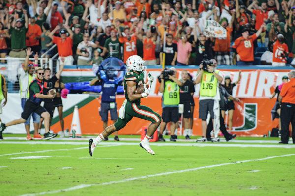 Travis Homer (24) scores the winning touchdown against Syracuse