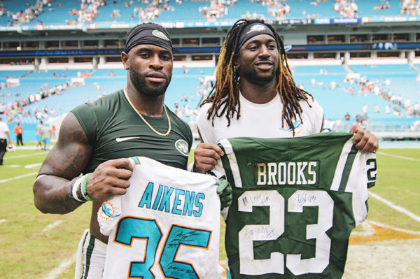 Walt Aikens and Terrence Brooks exchange jerseys