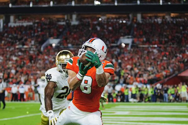 Braxton Berriod (8) hauls in a touchdown
