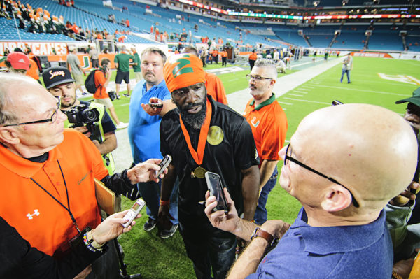 Ed Reed speaks to reporters after the game