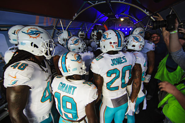 Dolphin players huddle in the tunnel for a pregame speech
