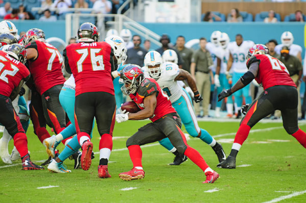 Doug Martin (22) tries to find some running room