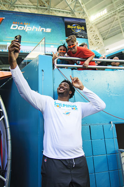 Rookie Eric Smith takes a selfie with fans