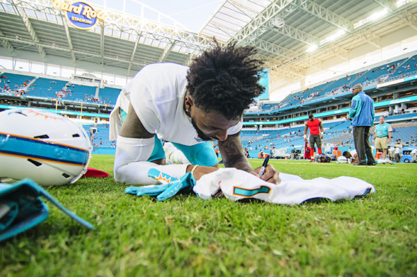 Jarvis Landry signs his jersey