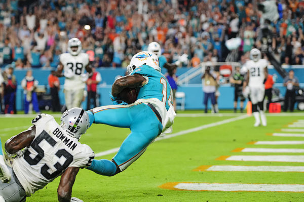 Jarvis Landry (14) twists his way in for a touchdown