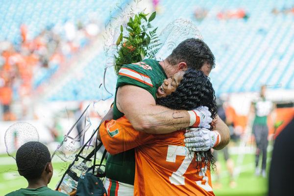 Senior KC McDermott hugs fellow senior, Trevor Darling's mother