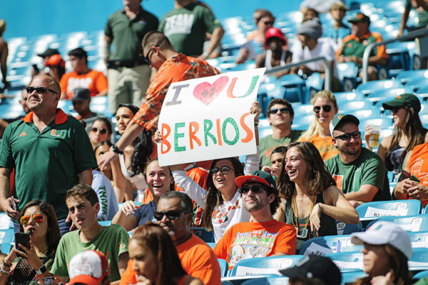 A fan holds a sign up for Braxton Berrios