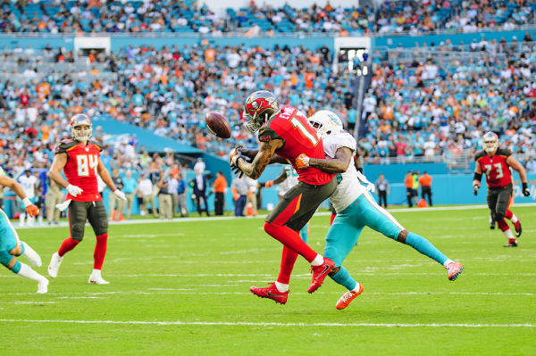Xavien Howard (25) tips the ball away from Mike Evans (13)