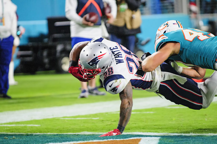 James White (28) lunges in for the touchdown