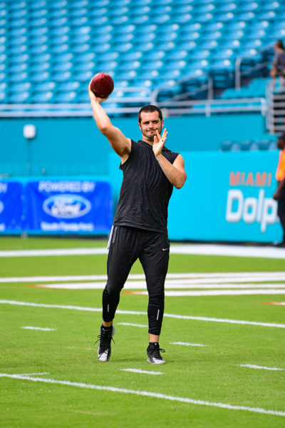 Oakland Raiders quarterback Derek Carr (4) warms up